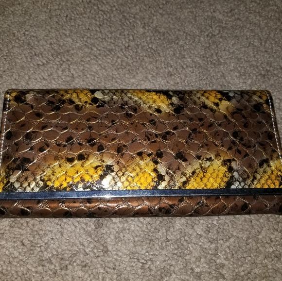 depenche new york Handbags - Snake skin wallet